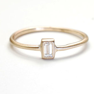 photo of Gold Baguette Diamond Engagement Ring by Etsy seller Nixin, $385