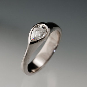 photo of Moissanite Tear Drop Engagement Ring in Silver/ Palladium by Etsy seller NodeformWeddings, $530