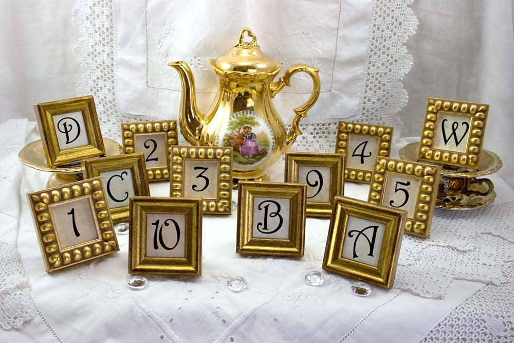 Weddings-by-style-parisian-romance-wedding-decor-inspiration-gold-table-numbers.full