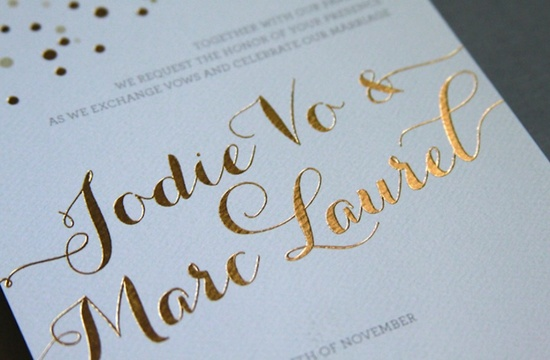 photo of beautiful wedding invitations metallic foil stamping gold white detail