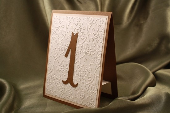 photo of embossed wedding inspiration from Etsy rustic table numbers