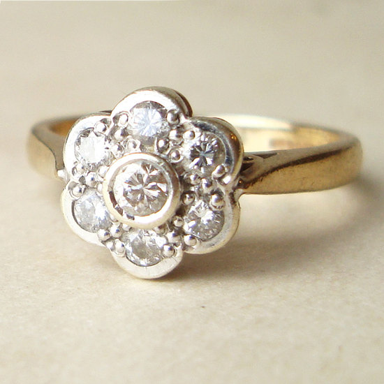 photo of Vintage .25 Carat Diamond Daisy Flower Ring, $385
