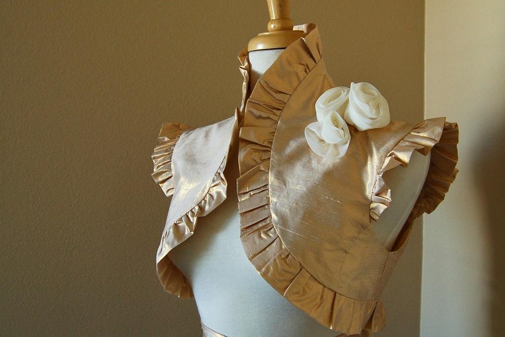 Beautiful-bridal-boleros-to-top-a-simple-wedding-dress-metallic-gold.full